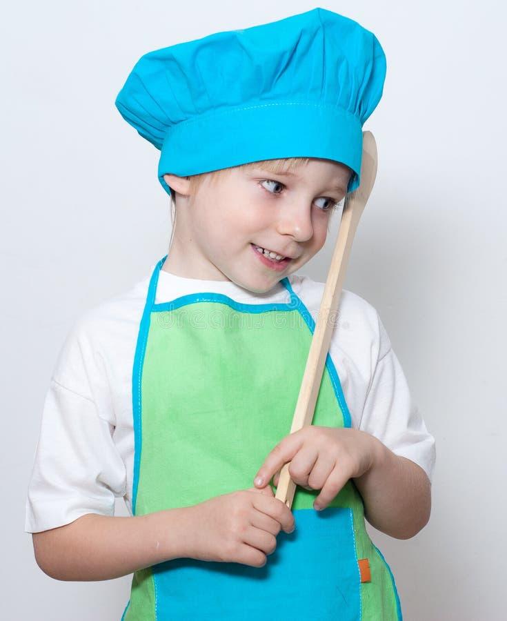 Kind als chef-kokkok stock afbeeldingen