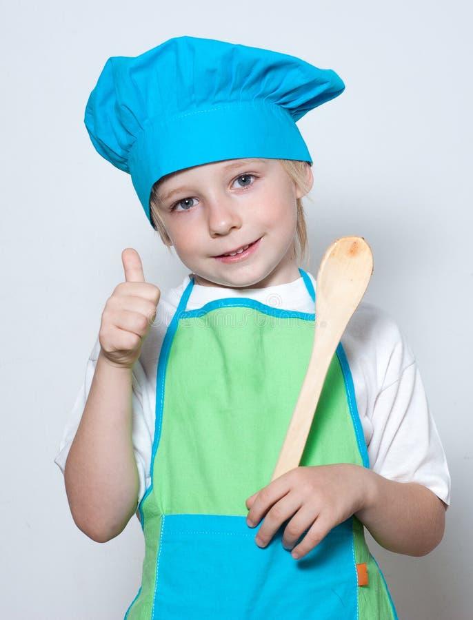 Kind als chef-kokkok royalty-vrije stock afbeelding