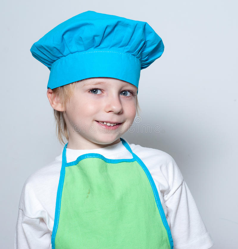 Kind als chef-kokkok stock afbeelding