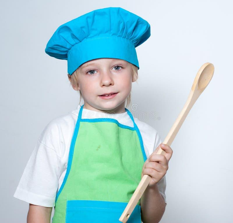 Kind als chef-kokkok royalty-vrije stock foto's