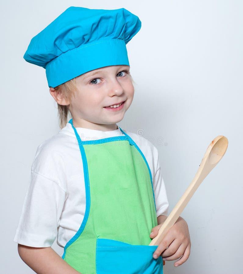 Kind als Chefkoch stockfotos