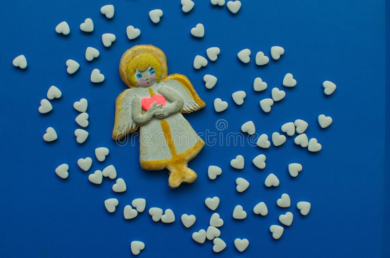 Kind angel and tablets stock image