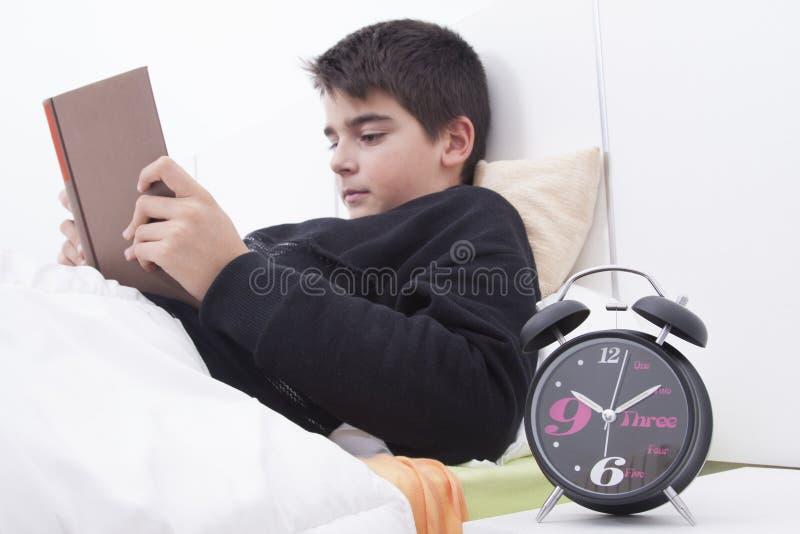 Kind in bedlezing royalty-vrije stock afbeeldingen