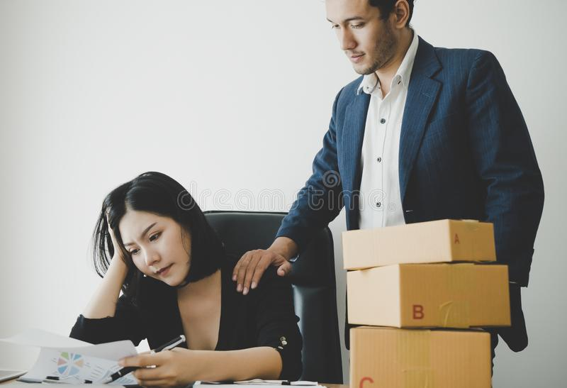 Kind boss is helping and consolating an upset worker. Kind boss is helping and supporting an upset worker royalty free stock photos
