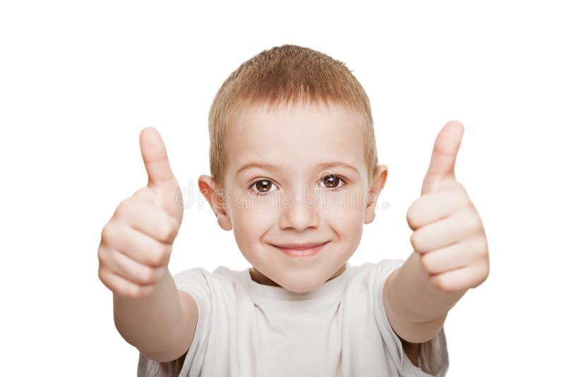 Kind, das oben Daumen gestikuliert stockbilder