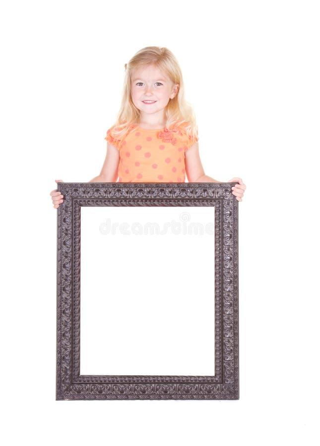 Kind dat groot leeg frame houdt royalty-vrije stock foto's
