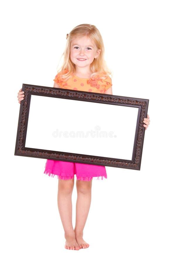 Kind dat leeg frame houdt royalty-vrije stock afbeeldingen