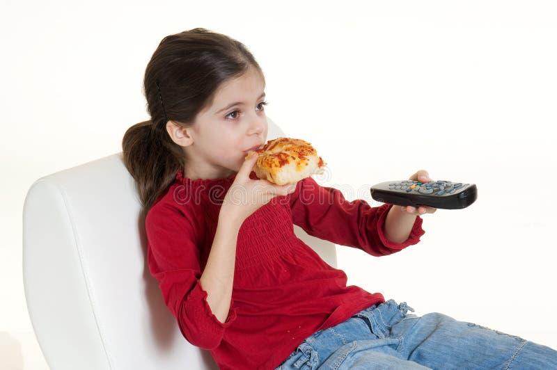 Kind dat pizza eet stock fotografie