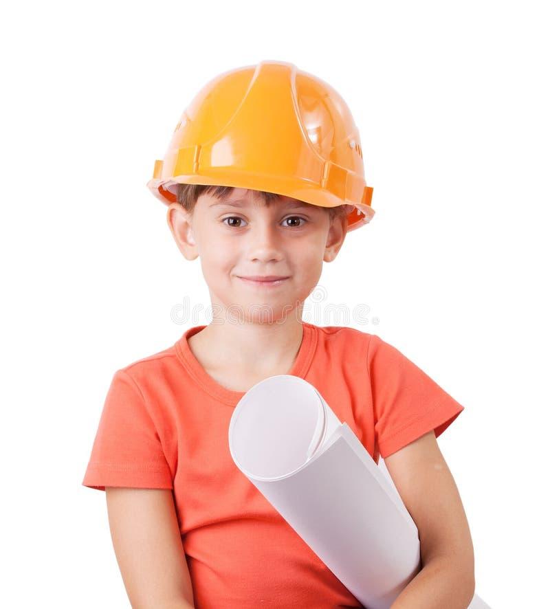 Kind in de bouwhelm stock afbeelding