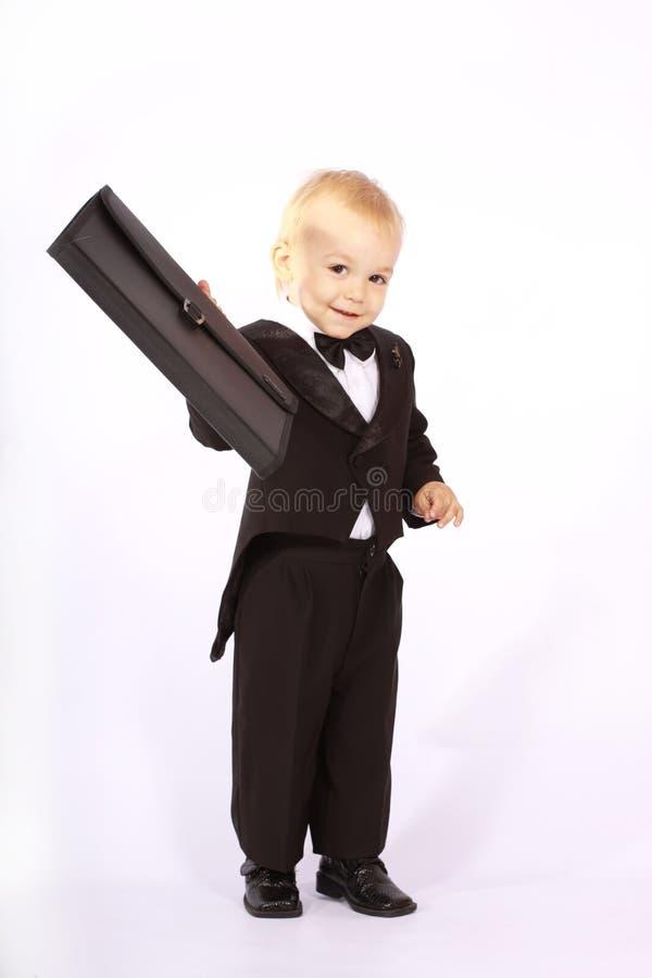 Kind in een smoking stock afbeeldingen