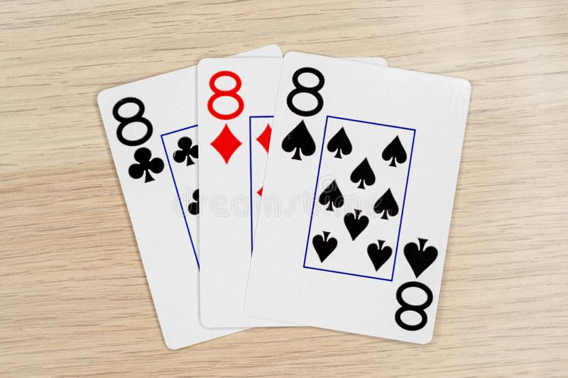 3 of a kind eights 8 - casino playing poker cards stock photos