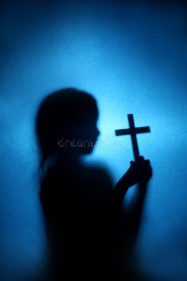 Kind en kruis stock foto's