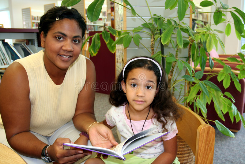 Kind en Leraar stock foto's