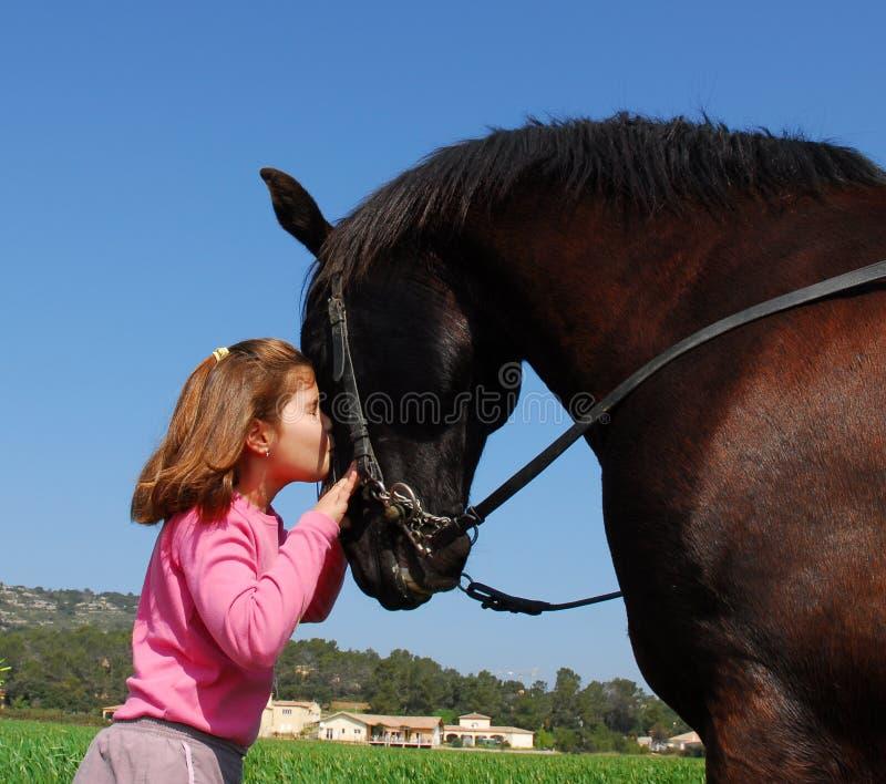 Kind en paard royalty-vrije stock afbeelding