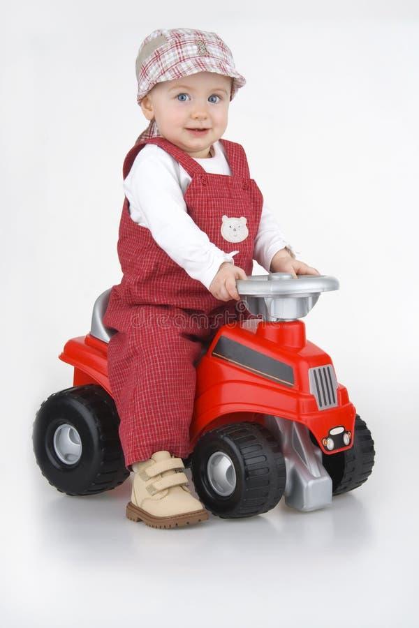 Kind en stuk speelgoed - auto royalty-vrije stock foto