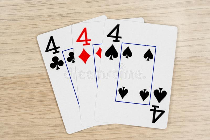 3 of a kind fours 4 - casino playing poker cards stock photography