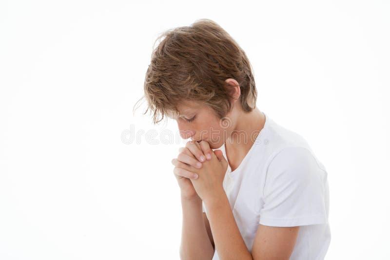 Kind in gebed het bidden stock afbeelding