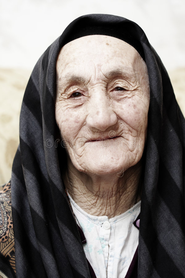 Kind grandma. Very old grandmother looking to camera with kind stock images
