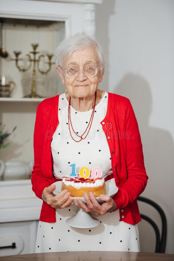 Kind grandmother is celebrating her 100th birthday at home royalty free stock image