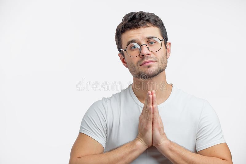 A kind guy is begging foregivenessfor a lifetime of transgressions stock photography
