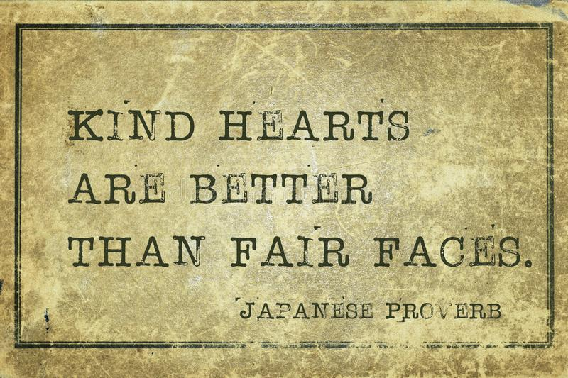 Kind hearts JP. Kind hearts are better than fair faces - ancient Japanese proverb printed on grunge vintage cardboard royalty free stock images