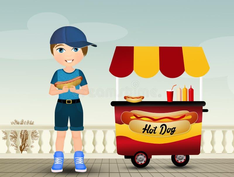 Kind isst den Hotdog lizenzfreie abbildung