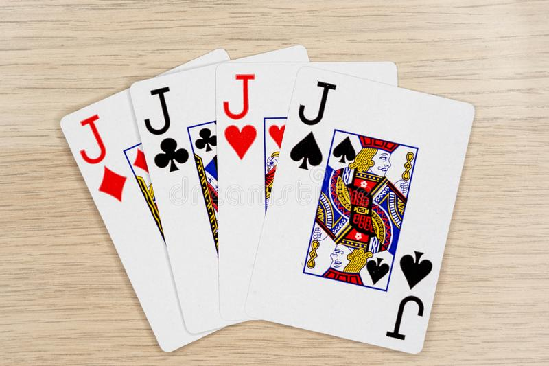 4 of a kind jacks - casino playing poker cards stock images