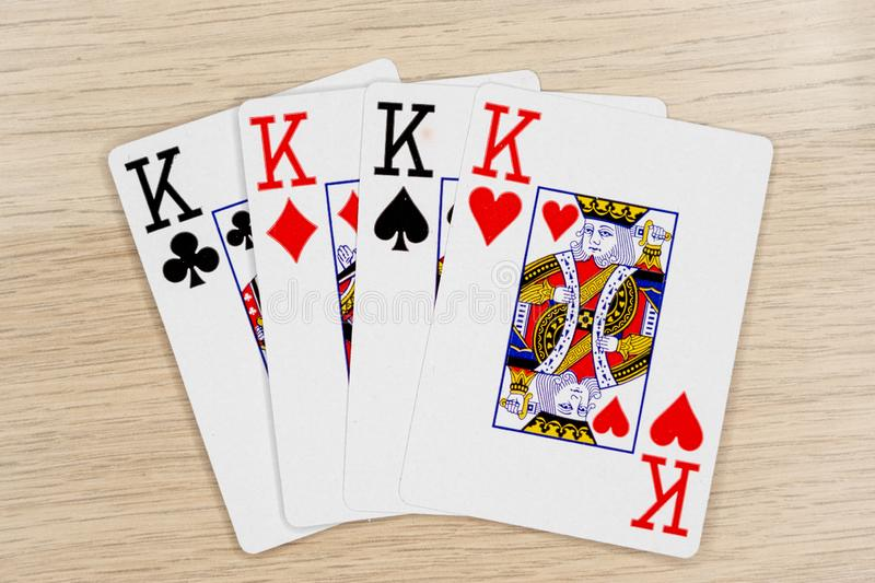 4 of a kind kings - casino playing poker cards stock images
