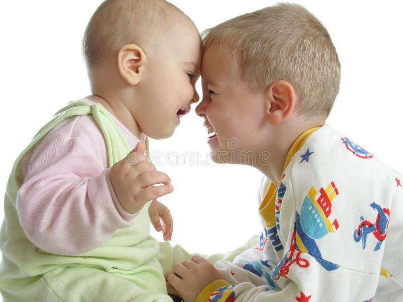 Download Kind met baby op wit stock afbeelding. Afbeelding bestaande uit zuster - 295151