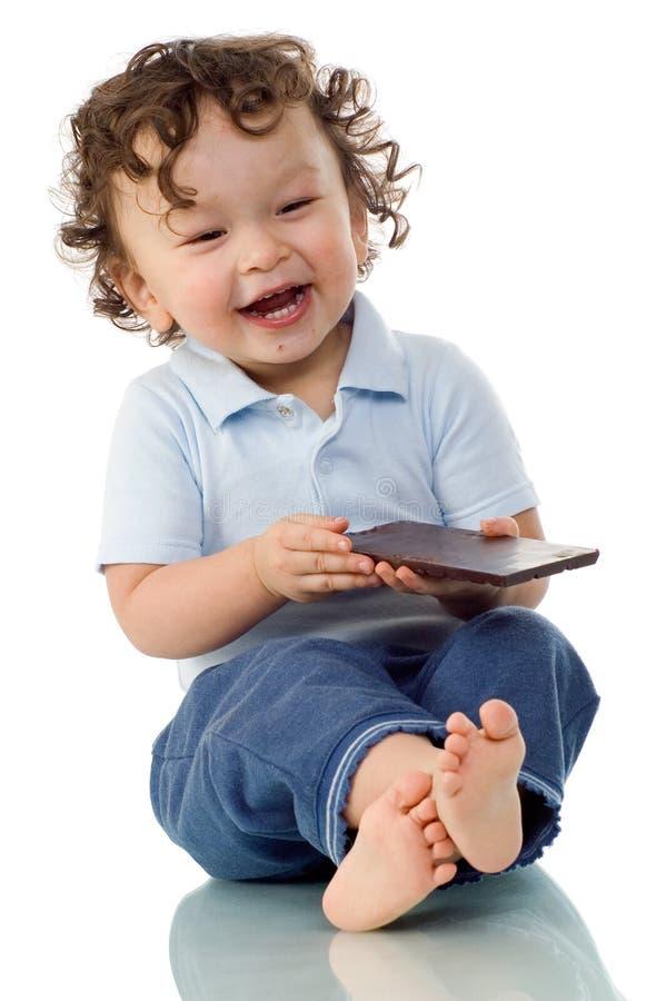 Kind met chocolade. stock afbeelding