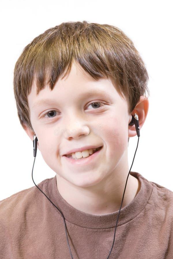 Kind met earbuds stock fotografie