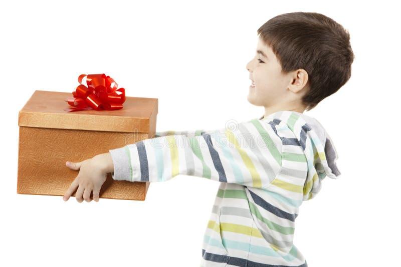 Kind met een gift stock afbeeldingen