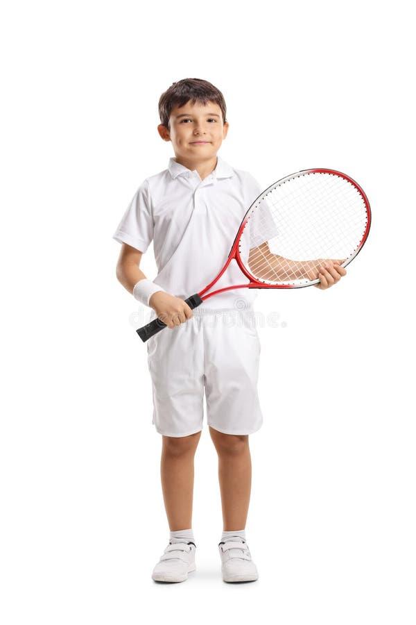 Kind met een tennisracket die bij de camera glimlachen royalty-vrije stock fotografie