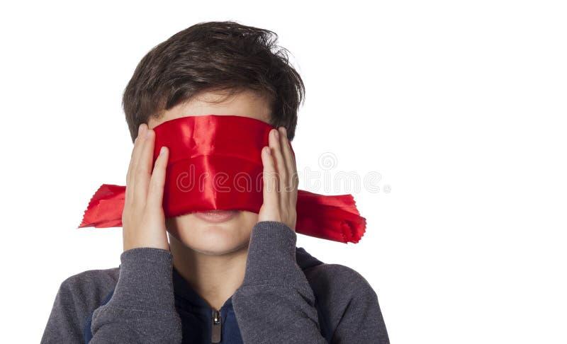 Kind met geblinddochte ogen stock afbeelding