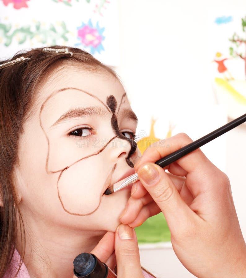 Kind met gezicht het schilderen. stock afbeelding