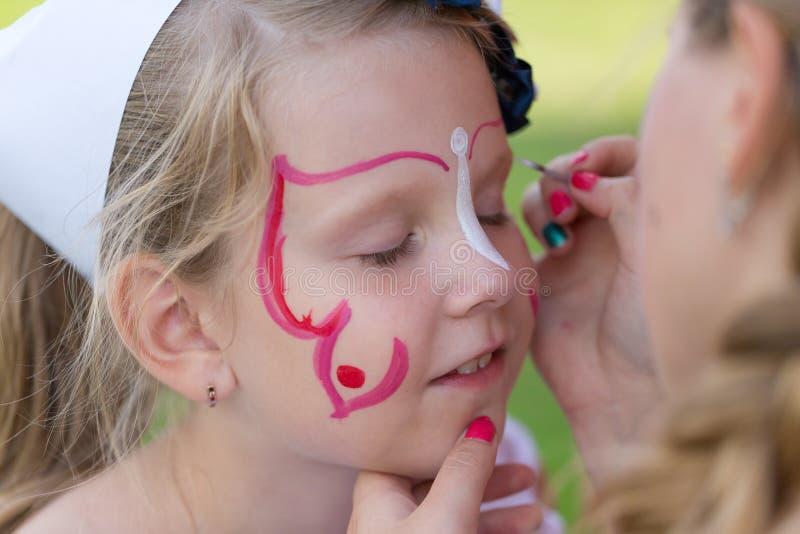 Kind met gezicht het schilderen stock afbeeldingen
