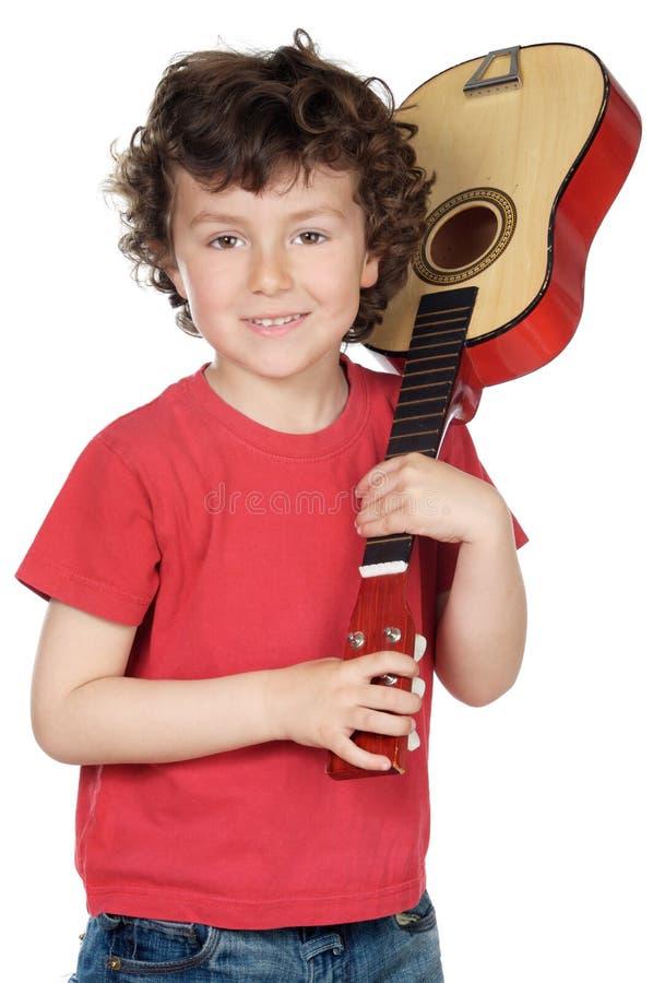 Kind met gitaar stock fotografie