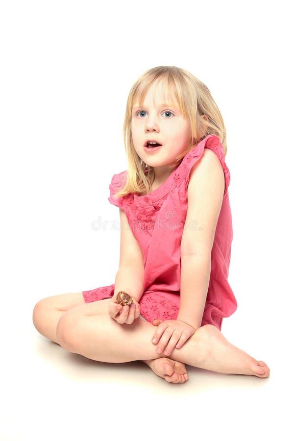 Kind met suikergoed op wit stock afbeelding