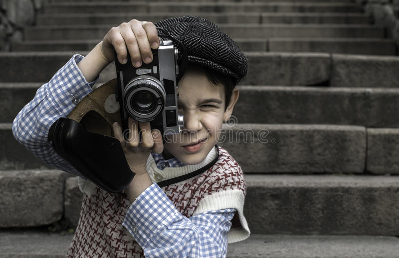 Kind met uitstekende camera stock foto's