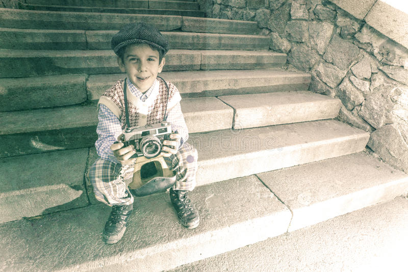 Kind met uitstekende camera stock foto
