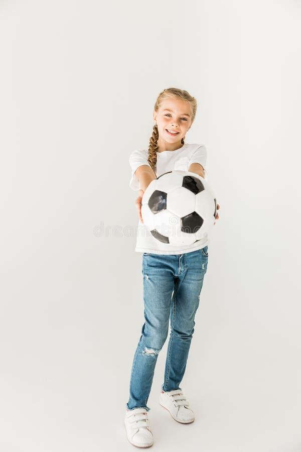 Kind met voetbalbal stock foto's