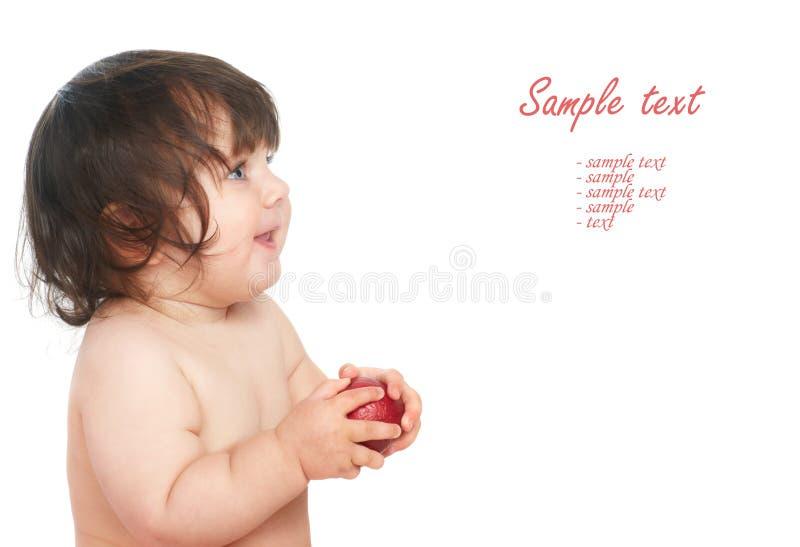 Kind mit Apfel lizenzfreie stockfotografie
