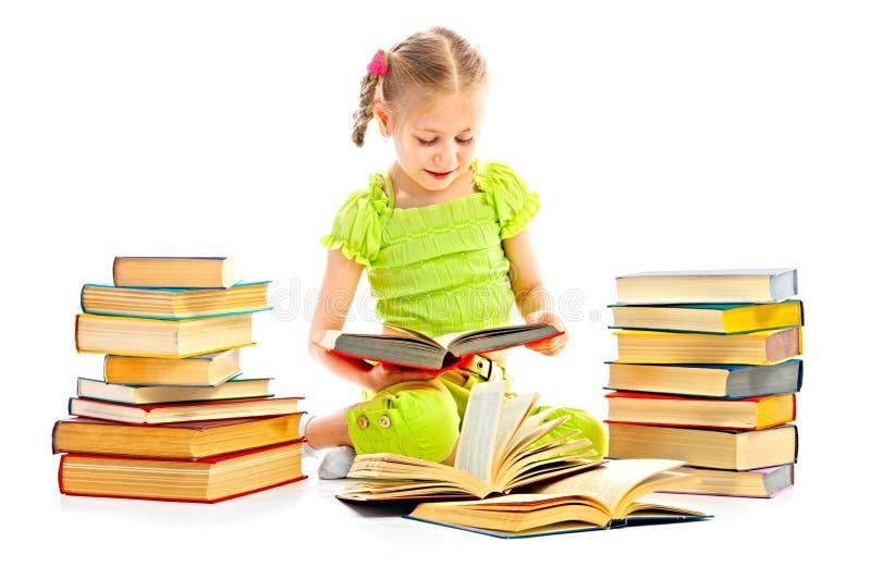 Kind mit Buch lizenzfreie stockbilder