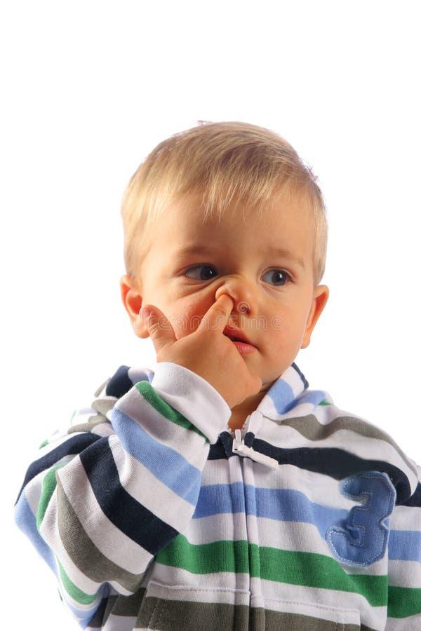Kind mit dem Finger in seiner Wekzeugspritze lizenzfreies stockbild