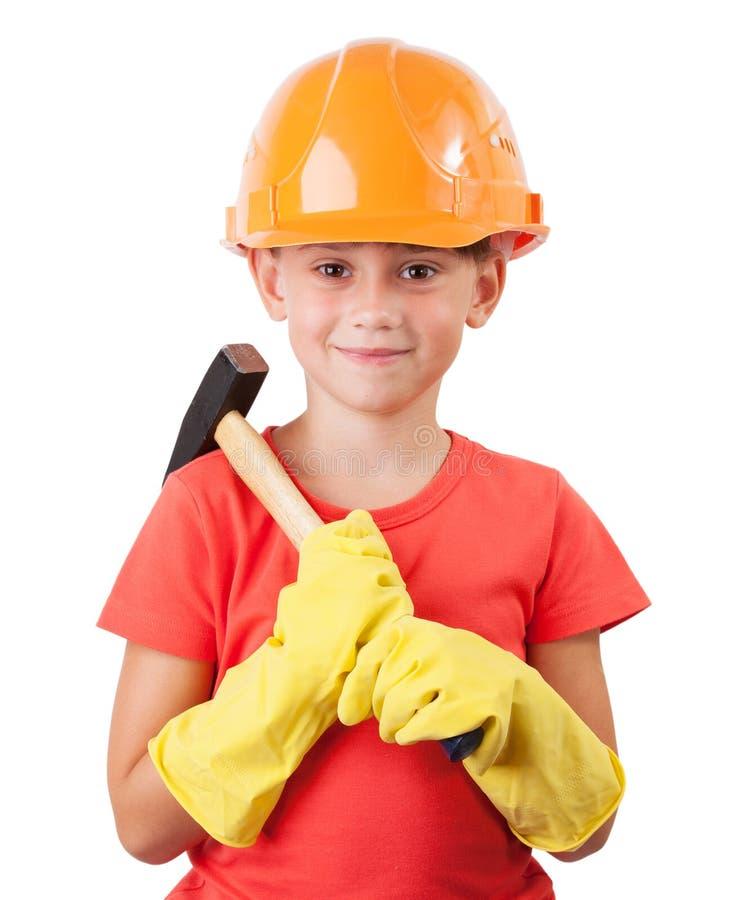 Kind mit einem großen Hammer stockfotos