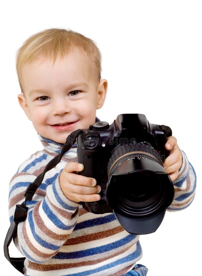 Kind mit einer Kamera stockbild