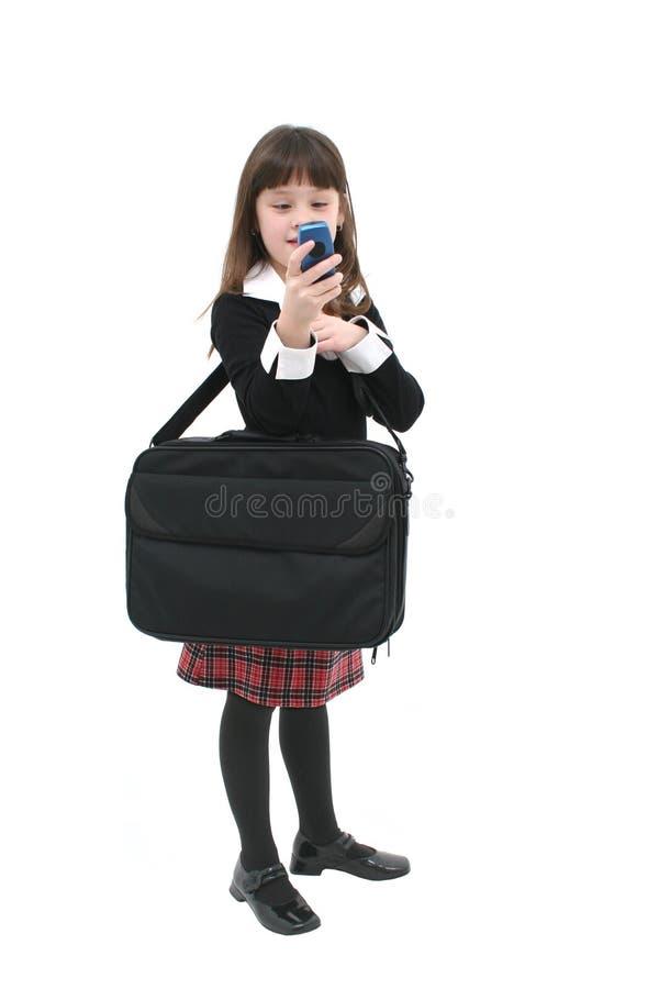 Kind mit Mobiltelefon lizenzfreie stockfotos