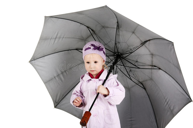 Kind mit Regenschirm stockbild