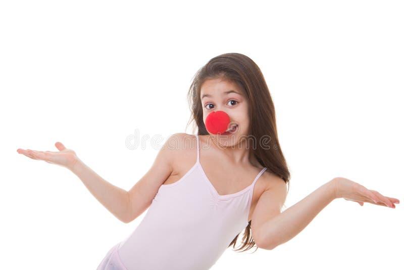 Kind mit roter Clownwekzeugspritze lizenzfreie stockfotos