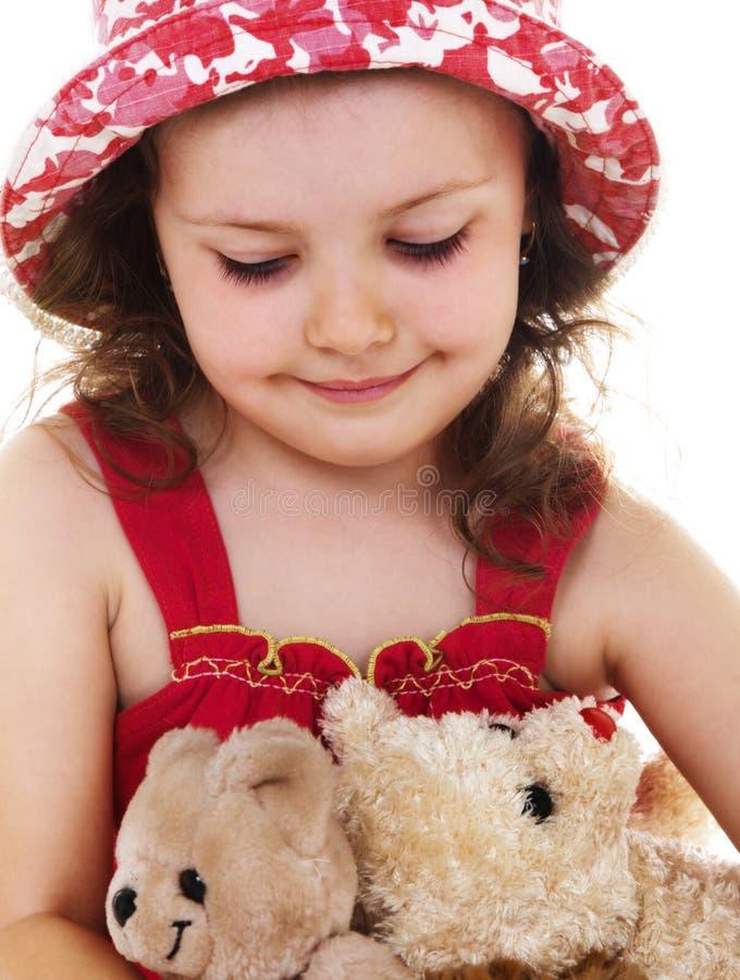 Kind mit Spielwaren lizenzfreies stockfoto